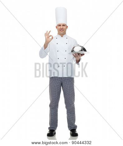 cooking, profession, gesture and people concept - happy male chef cook holding cloche and showing ok sign