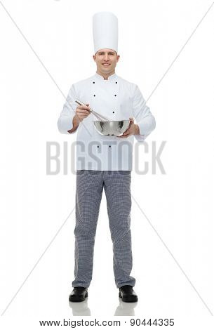 cooking, profession and people concept - happy male chef cook holding bowl and whipping something with whisk