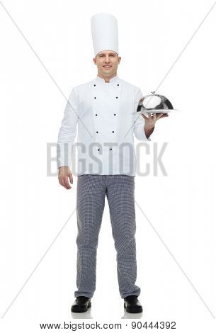 cooking, profession and people concept - happy male chef cook holding cloche