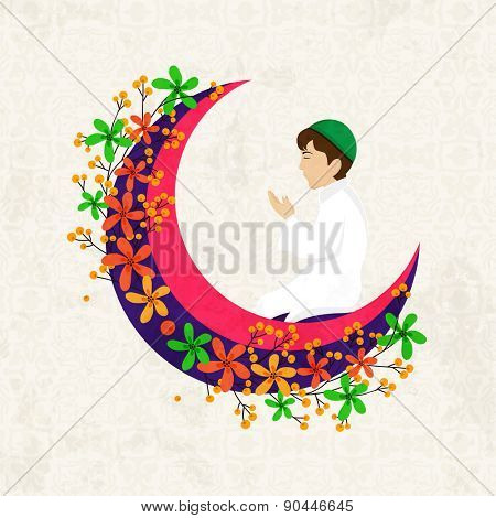 Religious Muslim young boy praying Namaz (Muslim prayer) on beautiful flowers decorated pink moon for holy month of prayers Ramadan Kareem celebrations.