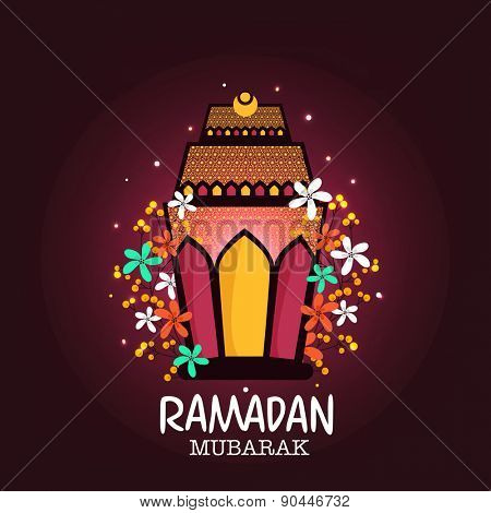Illuminated beautiful lantern decorated with colorful flowers on purple background for Islamic holy month of prayers Ramadan Mubarak celebrations.