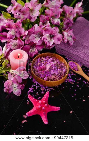 Spa background-pink orchid , candle, salt in bowl,starfish