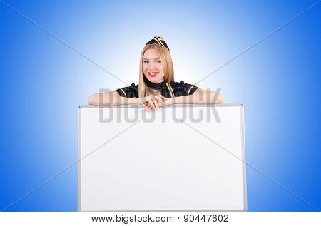 Woman stewardess with blank board