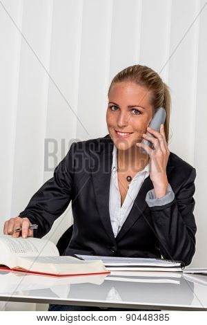 businesswoman sitting in an office. symbol photo for managers, self or lawyer.