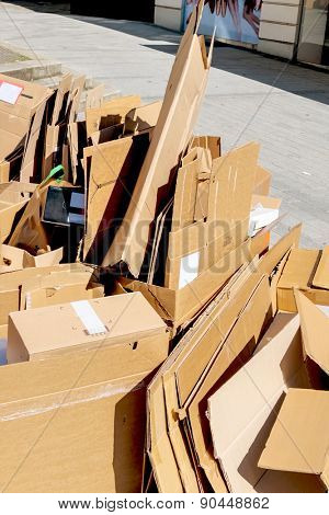 cartons waiting to be picked up by the garbage trucks. recycling of waste paper.