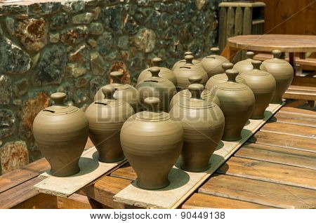 Many pots kept for drying in the sun