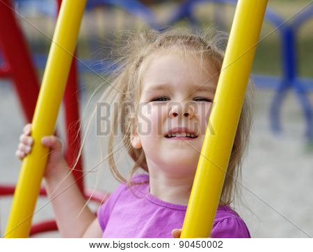 little girl on the playground.