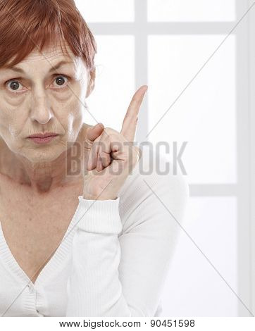 Sixty years woman  and finger warning