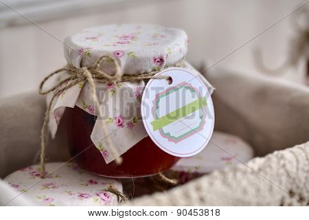 Close up of a jar jam with empty tag