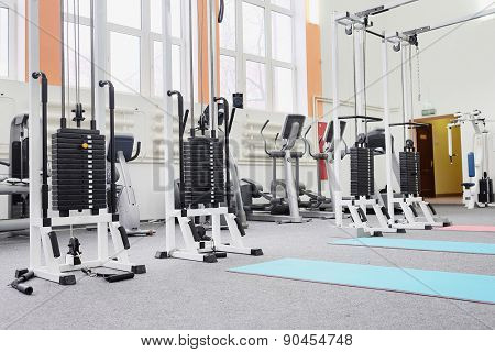 Gym centre interior. Equipment, gym apparatus.