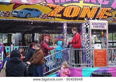 Coquitlam, BC, Canada - April 09, 2015 : People line up for entering bumper cars section at the West Coast Amusements Carnival