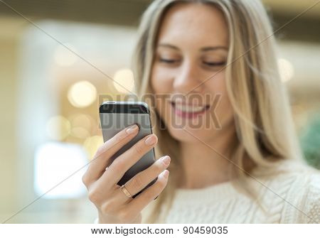 Women using mobile phone on the bokeh background