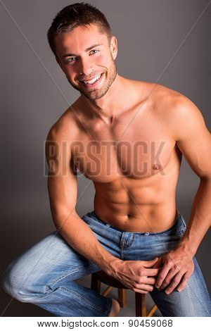 Portrait of an attractive smiling man shirtless