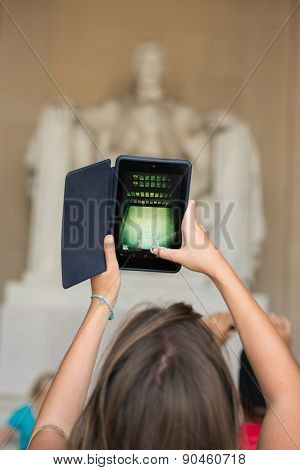 Washington DC - A woman takes picture with a tablet in Lincoln Memorial