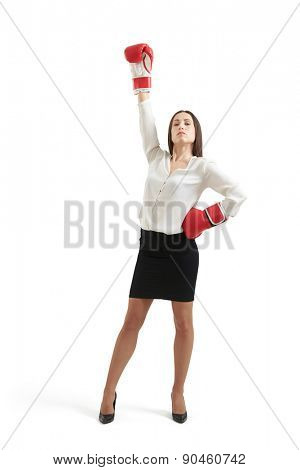 winner businesswoman in formal wear and red gloves raising one hand up and looking with confidence at camera. isolated on white background
