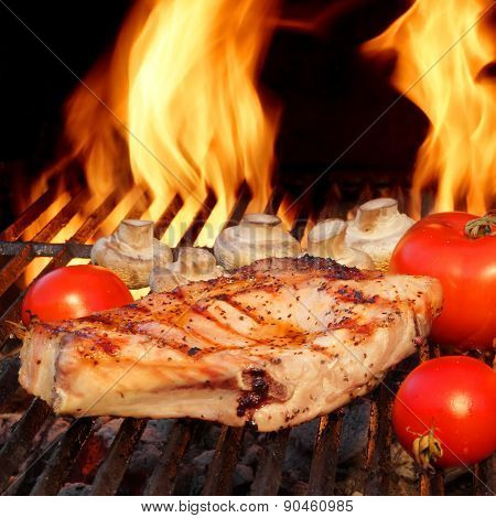 Pork Rib Steaks, Tomato And Mushrooms On Hot Bbq Grill
