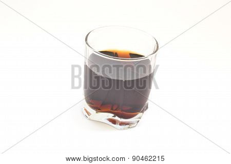 A Glass Of Whiskey On A White Background On The Table