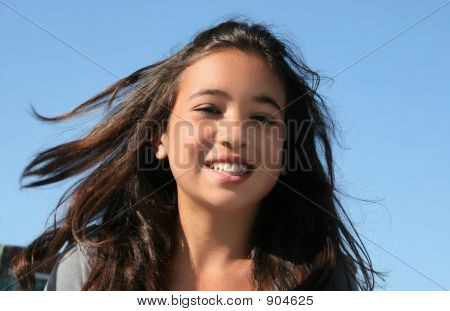 Happy Girl With Flowing Hair