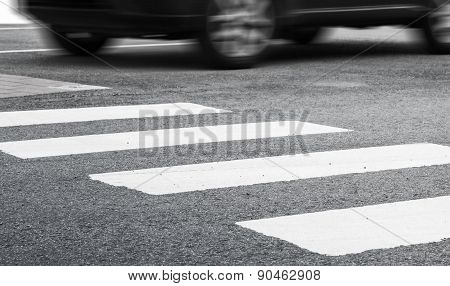 Pedestrian Crossing Marking And Fast Moving Car