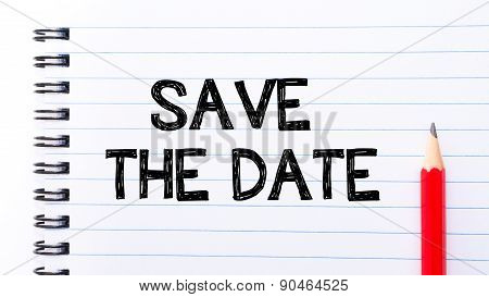 Save The Date Text Written On Notebook Page