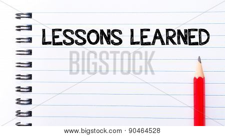 Lessons Learned Text Written On Notebook Page
