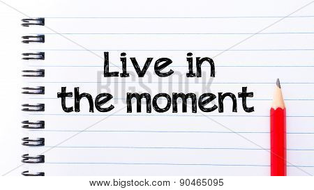 Live In The Moment Text Written On Notebook Page