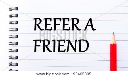 Refer A Friend Text Written On Notebook Page
