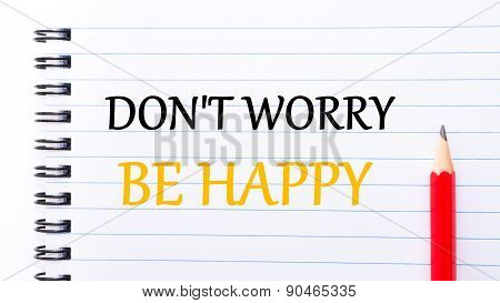 Do Not Worry Be Happy Text Written On Notebook Page