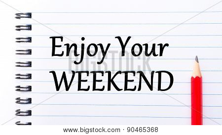 Enjoy Your Weekend Text Written On Notebook Page