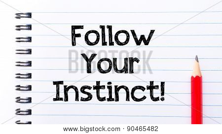 Follow Your Instinct Text Written On Notebook Page