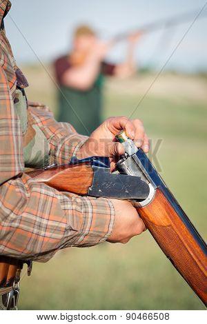 Hunter loading shotgun