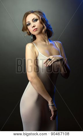 Advertising of jewelry. Sexy model in negligee