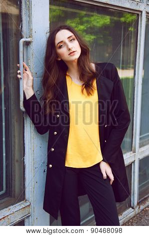 Young woman in black trenchcoat