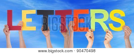 Hands Hold Colorful Straight Word Letters Blue Sky