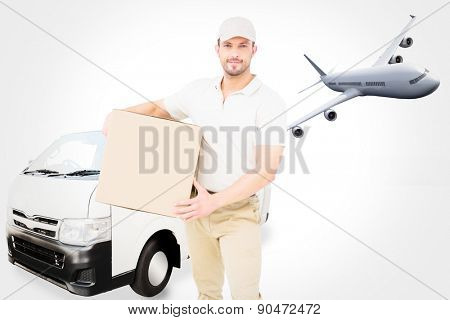 Delivery man carrying cardboard box against graphic airplane