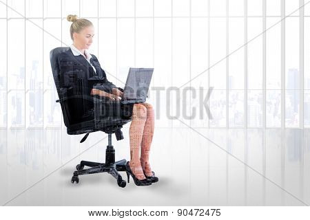 Businesswoman sitting on swivel chair with laptop against high angle view of city