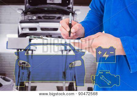 Mechanic writing on clipboard against auto repair shop