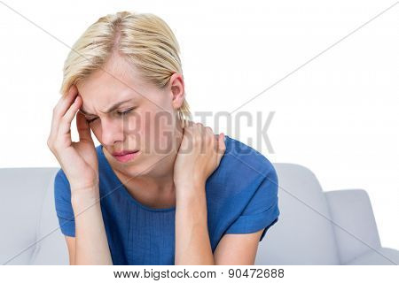 Attractive woman having headache on white background