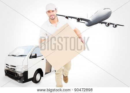 Delivery man with cardboard box running against graphic airplane