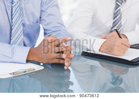 Businessmen at conference in the meeting room
