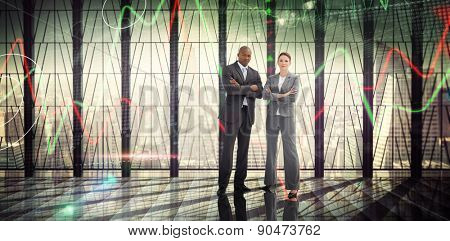 Confident business team against stocks and shares on black background