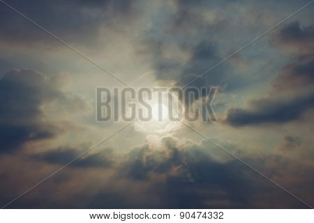 Sky With Cumulus Clouds And A Bright Sun Closeup