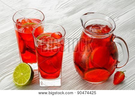Coctail. Refreshing summer drink with Strawberry in jug and glass on white wooden table