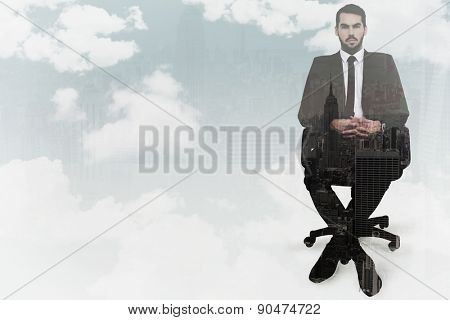 Stern businessman sitting on an office chair against new york skyline