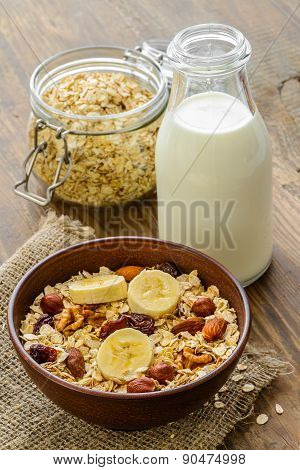 Healthy breakfast - whole grain muesli with a banana and nuts