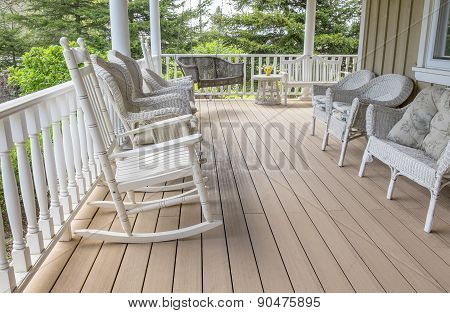 Veranda Filled with White Wicker Furniture