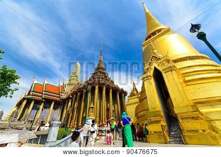 Tourists Travel To Wat Phra Kaew And Grand Palace In Bangkok, Thailand