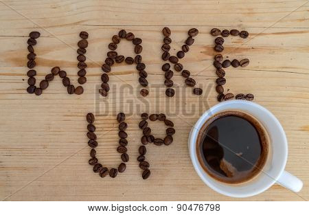 Cup of coffee on wooden background and wake up coffee beans
