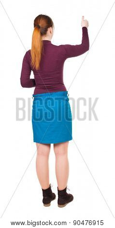 back view of woman. Young woman in vest presses down on something. Isolated over white background. Rear view people collection. backside view of person. Red-haired girl approves.