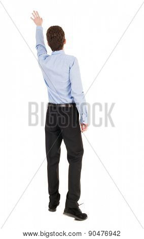 Back view pointing business man. gesticulating young guy in black suit. Rear view people collection. backside view of person. Isolated over white background.  Businessman accompanies departing plane.